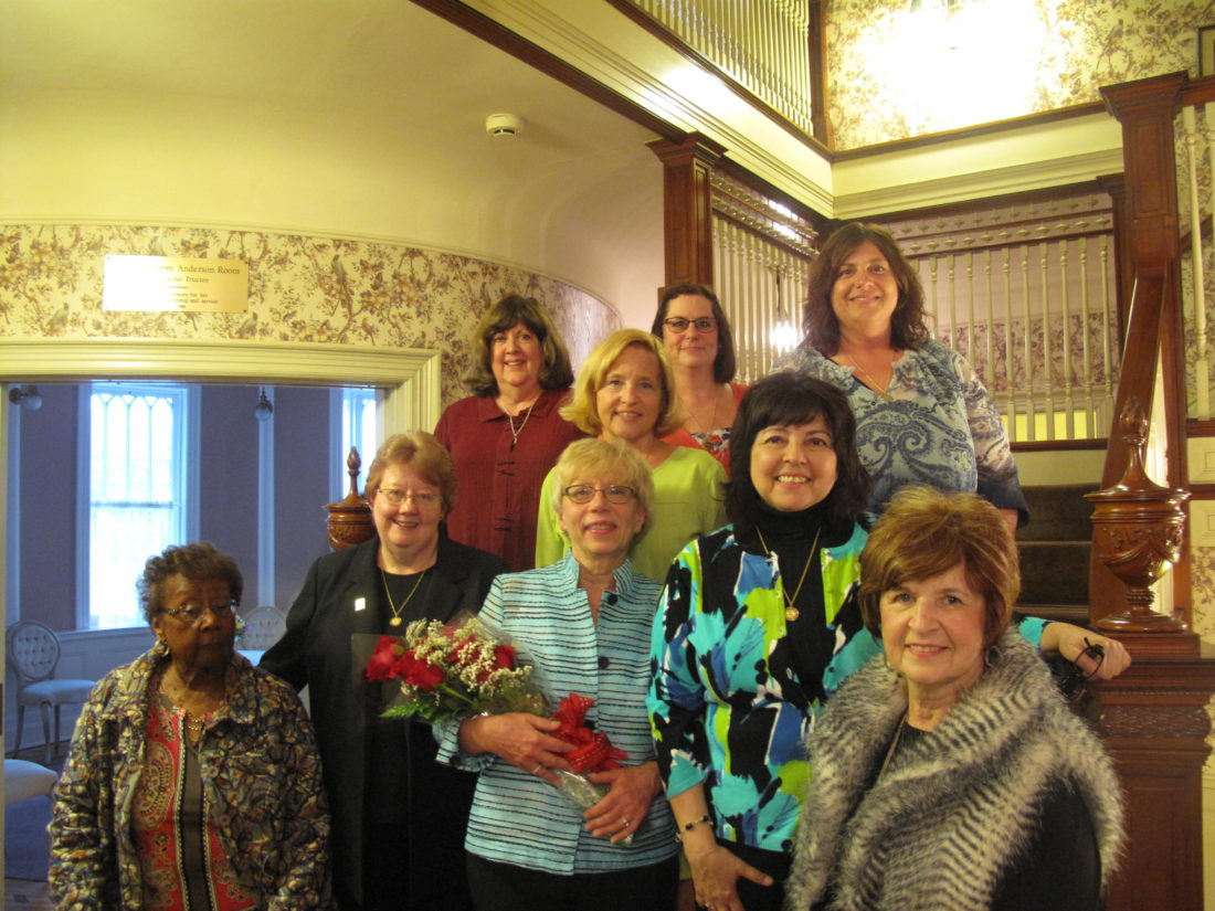 Pictured is Carol Drake, holding flowers in center, who was named the 2016 Woman of the Year at the Jamestown Interclub Council's 61st Annual Woman of the Year banquet at the Marvin House on Monday. Also pictured are previous recipients of the honor. P-J photo by A.J. Rao