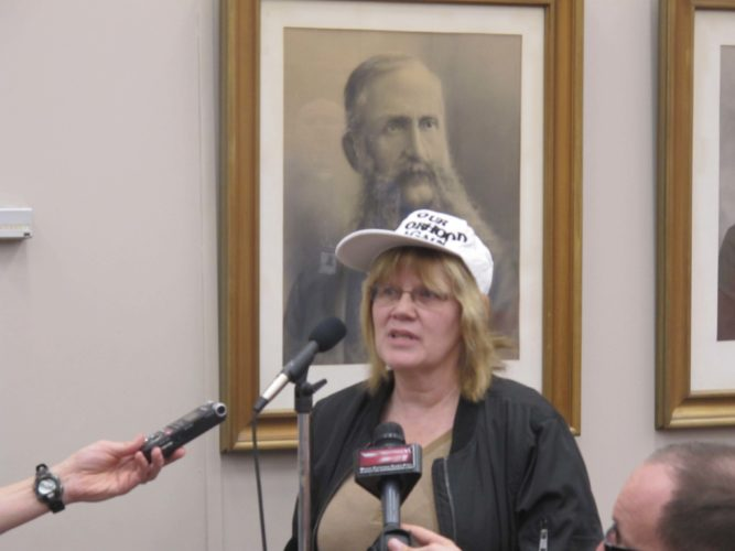 Darlene Pangborn, Spring Street resident, speaking in favor of the proposed Jackson Spring apartments and housing complex that might be built along North Main and Spring streets. Pangborn and Donald Paine, Spring Street resident, wore matching hats that stated ''Make Our Neighborhood Great Again'' while speaking in favor of the Jackson Spring project. P-J photo by  Dennis Phillips