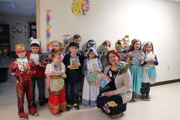 Kelly Vik, a Bethel Baptist Christian Academy teacher, is pictured with first- and second-graders wearing story book character costumes.