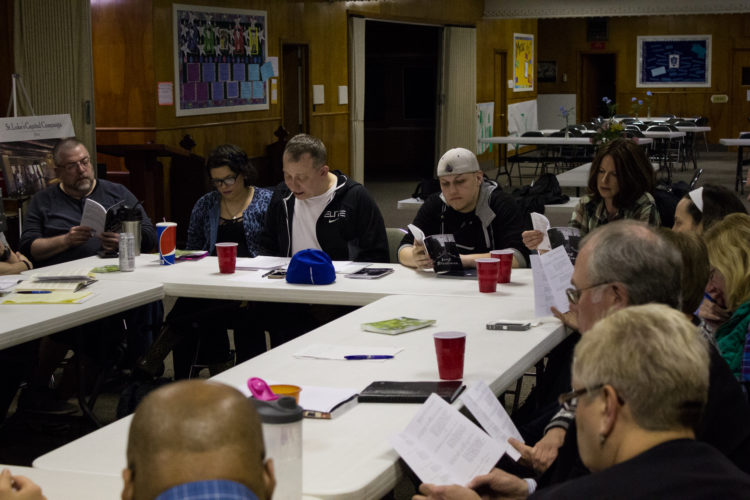 "Steven Cobb, director, pictured at center, and cast members of the original Jamestown play ""Least Resistance"" are pictured during a table read. The play features 22 local actors and discusses real-life stories of Jamestown area residents' struggles with addiction and recovery. It will be performed at the Willow Bay Theater at 7:30 p.m. on the following dates: Friday, April 28; Saturday, April 29; Friday, May 5; and Saturday; May 6."