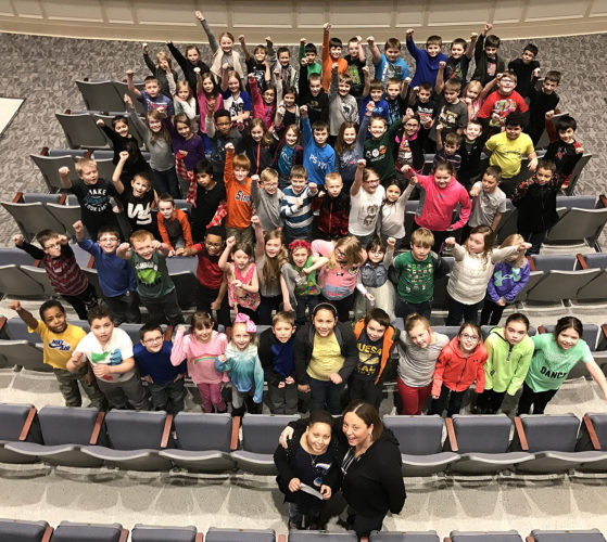 Lincoln Elementary School third graders are pictured with fellow classmate Alexis Ackley and her mom, Kristin. The third grade class raised the most money for the Coin Wars to benefit Alexis, who is battling cancer.