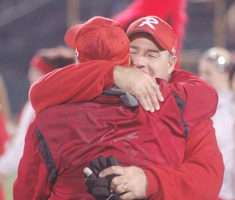 Greg Sherlock, right, hugs former Randolph football coach Pat Slater after the Cardinals' state semifinal victory in November 2012. P-J file photo by Scott Kindberg