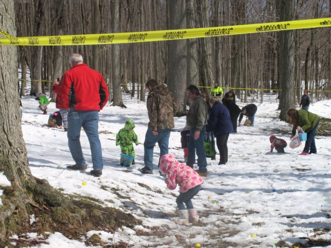 Kids flew through the snow at Midway State Park early Saturday morning to collect the brightly colored eggs during the first-ever Spring Egg Hunt.  P-J photo by Katrina Fuller