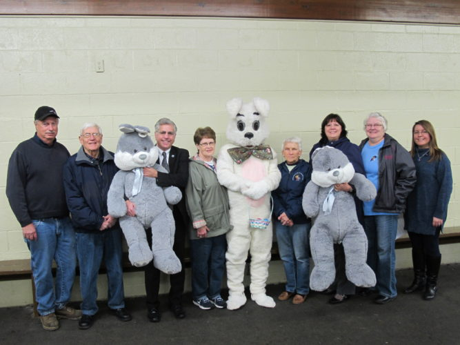 From left, John Williams, city parks manager; Roger Edborg, Sertoma Club of Jamestown; Sam Teresi, Jamestown mayor; Sandy Forsberg, Allen Park Women's Club; John Bauer as James The Easter Bunny; Carol Winterburn, Allen Park Women's Club; Cindy DiNapoli, City Parks, Recreation and Conservation Commission chairwoman; Audene Jarosz, Allen Park Women's Club; and Julia Ciesla-Hanley, city recreation coordinator; at the Allen Park Ice Rink to promote the 70th Annual Easter Egg Hunt at Allen Park to take place at 10:30 a.m. Saturday, April 15.  P-J photo by Dennis Phillips