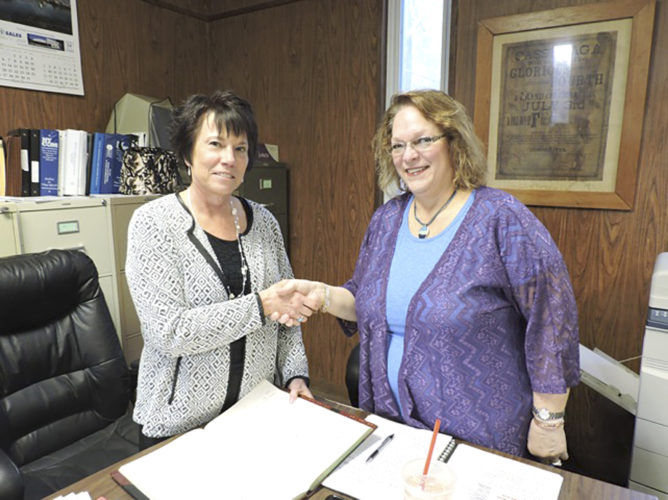 Village Clerk Roxanne Astry, pictured at left, congratulates new Cassadaga Mayor Mary Jo Bauer after being sworn in. Submitted photo
