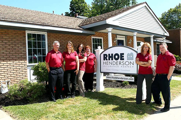 Rhoe Henderson, far left, and the staff of Rhoe B. Henderson Insurance Agency, located at 552 W. Third St. in Jamestown. The agency recently marked its 90th anniversary.