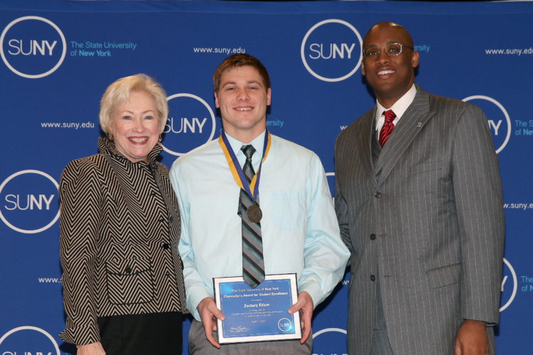 Zachary Eklum is pictured with Nancy Zimpher, SUNY chancellor, and Cedric Howard, SUNY Fredonia vice president for student affairs.
