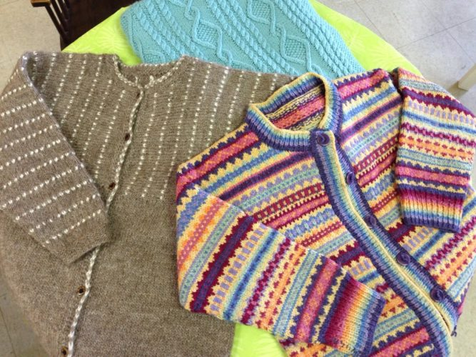 Yarn for Ewe is hosting a free sweater show on April 22. At the show, artisan Julie Gable will feature at least a dozen sweaters she has created and will talk to fellow knitters about her techniques.  Shown is a sampling of sweaters that will be featured at the sweater show. Submitted photo