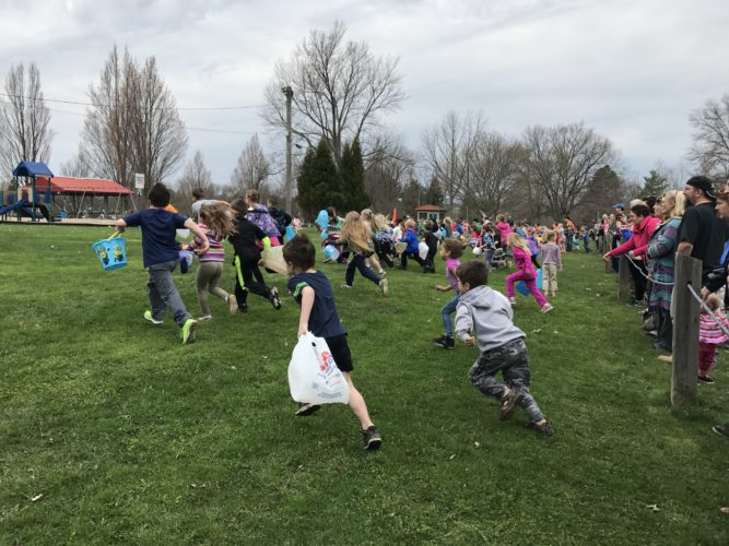 Hundreds of youngsters took off from the edge of the field for the 70th annual Easter Egg Hunt at Allen Park in Jamestown on Saturday. The children were divided into three age groups to collect the 3,000 plastic eggs filled with candy and coupons for prizes. P-J photo by Katrina Fuller