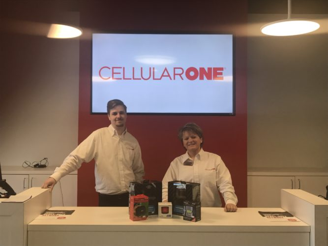 Josh Meier, Cell One wireless sales consultant, and Melody Madigan, district manager, are ready to welcome the public in to their new location at 720 Foote Ave. for the Grand Opening Celebration on April 22.  P-J photo by Katrina Fuller