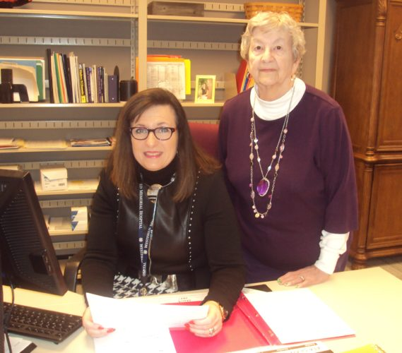 Ann Weidman, Westfield Memorial Hospital Foundation community relations chairperson, standing, and Patricia DiPalma, Westfield Memorial Hospital Foundation executive director, review the gifts given as memorials and honorariums in 2016. Submitted photo
