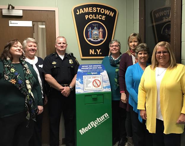 Raising awareness about the drug disposal drop box located at the Jamestown Police Department are Harry Snellings, Jamestown police chief, with members of HOPE Chautauqua's Adult Awareness and Education Committee, from left to right, Peggy Hallberg, Kathy Stornes, Eileen Goodling, Cecelia Nosel, Alison Espin and Sherry Osborne.