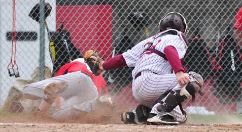 Maple Grove's Easton Tanner slides safely into home ahead of the tag from Dunkirk catcher Phillip Messina during Friday's CCAA Division 1 West baseball game in Bemus Point. P-J photo by Scott Reagle