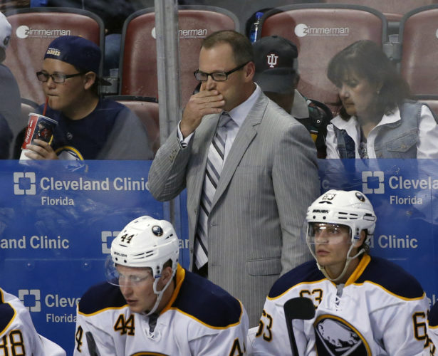 In this Oct. 15, 2015, file photo, Buffalo Sabres head coach Dan Bylsma looks on during the third period of an NHL hockey game against the Florida Panthers, in Sunrise, Fla.  The Buffalo Sabres have fired general manager Tim Murray and coach Dan Bylsma after the youthful team missed the playoffs for a sixth consecutive season. Owner Terry Pegula made the announcement Thursday, April 20, 2017. (AP Photo/Wilfredo Lee, File)