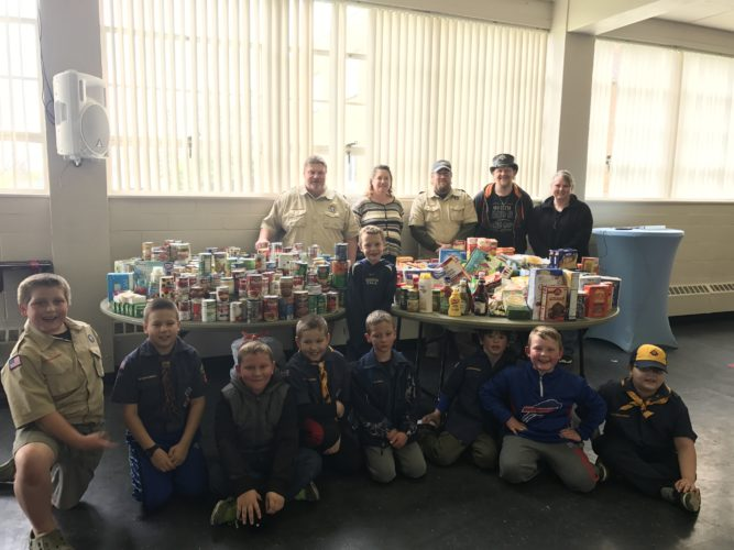Cub Scout Pack 115 collected and donated about 1,000 items to St. Susan Center on Saturday for their annual food drive. The scouts dropped flyers and shopping bags off in their neighborhoods on Friday night and traveled from house-to-house to collect the goods the next morning.  P-J photo by Katrina Fuller