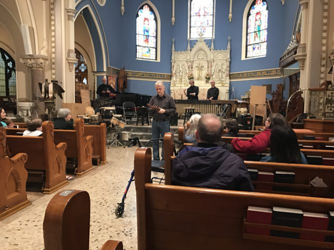 James Culley, Percussion Group Cincinnati, explains a few instruments he will use at St. Luke's Church on Saturday. Fellow group mates, Allen Otte and Russell Burge can be seen behind him.  P-J photo by Katrina Fuller