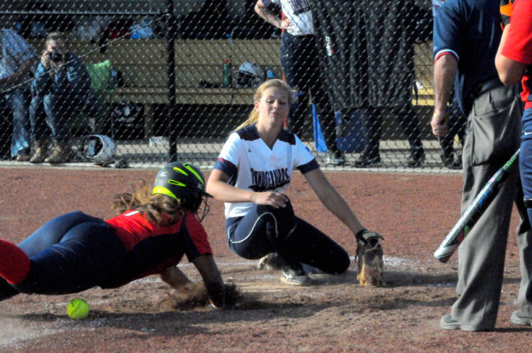 Southwestern's Samika Mathews dives safely into home as the throw gets away from Chautauqua Lake's Olivia Anderson during the sixth inning of Monday's CCAA Division 1 West softball game in Mayville. P-J photo by Matt Spielman