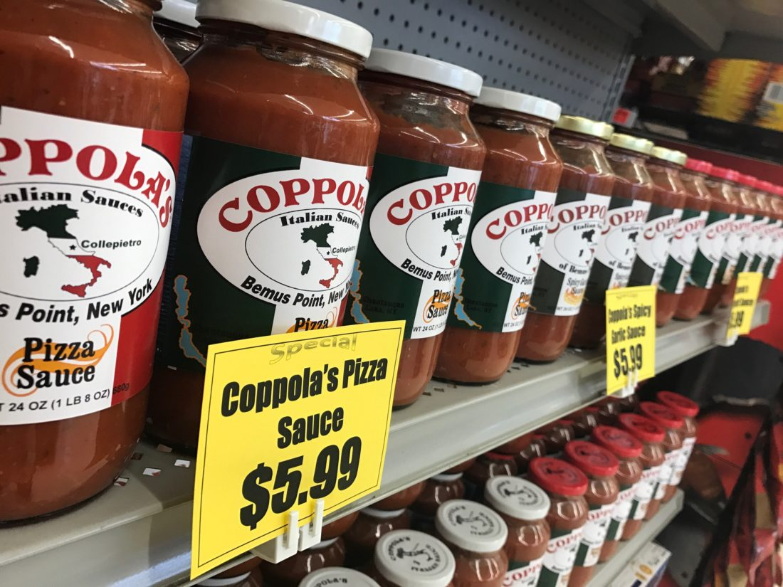 """Pictured is a shelf of Coppola's Pizza Sauce at Farm Fresh Foods in Jamestown. The business plans to rebrand itself after receiving a """"cease and desist letter from director Francis Ford Coppola.  P-Jphoto by Katrina Fuller"""