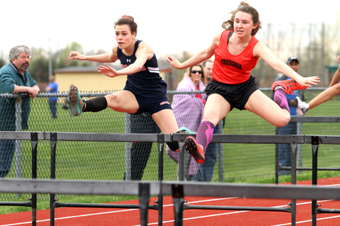 Katja Kranzo of Southwestern, left, and Melinda Waag of Fredonia battle it out for an eventual second- and third-place finish in the 100 hurdles during Tuesday's CCAA Division 1 track and field meet. P-J photo by Lisa Monacelli