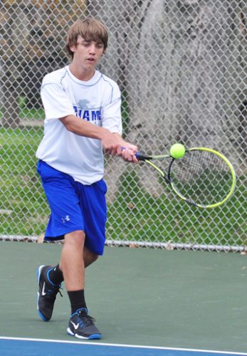 Panama's Carson Heimberg returns a volley during Tuesday's CCAA tennis match against Maple Grove. P-J photo by Scott Reagle