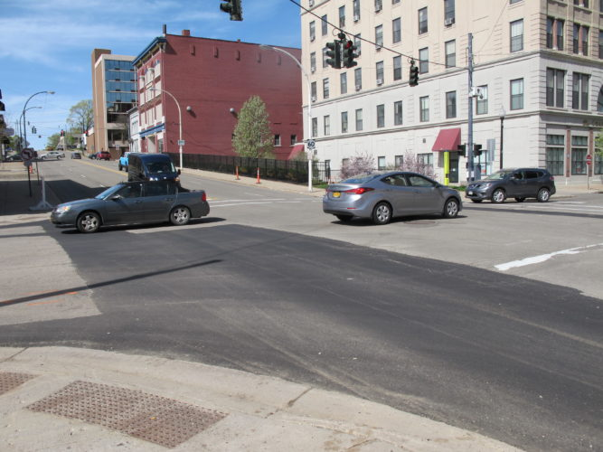 The intersection of Third and Washington streets following the patching of a giant pothole. City and county road crews have started to patch potholes now that asphalt can be used because of warmer temperatures. P-J photo by Dennis Phillips