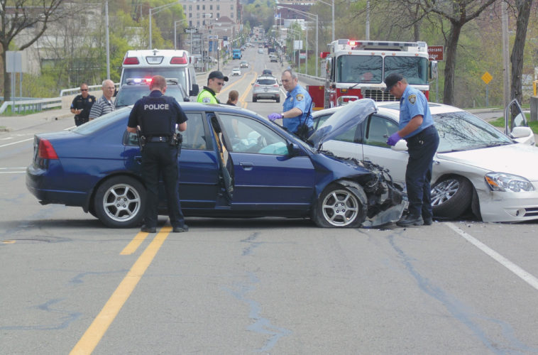 A woman was transported to the hospital for minor injuries following a crash on West Third Street in the city Thursday.  P-J photo by Jimmy McCarthy