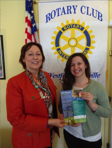 Katie Huba, Mercyhurst North East Oasis program director, pictured at right, shows some program literature to Sue Hammond, Rotary Club of Westfield-Mayville public relations chair. Huba was the guest presenter at the April 11 Rotary Club meeting and Hammond was the program sponsor. Photo by Adele Harrington