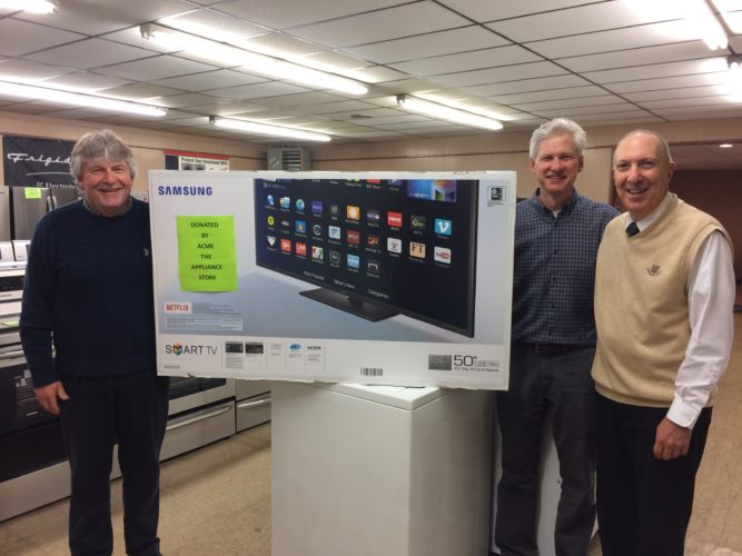 Pictured from left are Jim Pullan, chair, Vince Messina Memorial Golf Tournament; Dan Hocking, owner of ACME the Appliance Store; Jim Bellitto; and Vince Messina Memorial Golf Tournament committee chair member.Being showcased is the 50-inch Samsung smart television set donated by ACME the Appliance Store.