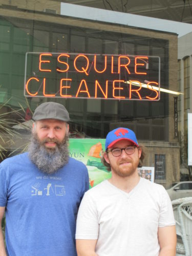 From left, Nathan Bailey, Esquire Cleaners owner, and Tyler Carroll, Esquire Cleaners manager, in front of Esquire Cleaners, located at 302 E. Second St., Jamestown. Bailey, who is the new owner of Esquire Cleaners, has made changes like now accepting credit cards since taking over operations from previous owner, Linda Crossley. P-J photo by Dennis Phillips
