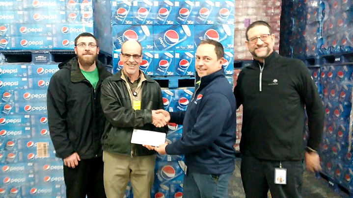 From left, Jamie Billquist presents Andrew Dickson of Chautauqua Hospice & Palliative Care with an $1,850 check. Also pictured is Matt Ehrman, left, and Fred Pellerito, right, of Pepsi of Jamestown. Submitted photo