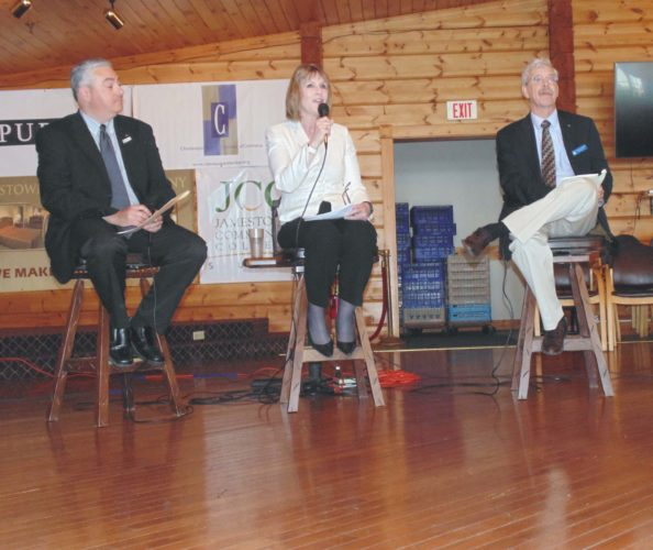 Assemblyman Andy Goodell and state Sen. Cathy Young discuss state issues during the County Chamber of Commerce's State Legislative Breakfast at the Lakewood Rod & Gun on Friday.  P-J photo by Jimmy McCarthy