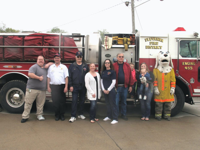 Pictured from left are Mike Taylor, Fluvanna volunteer firefighter; Ted Macri, second assistant chief; Bob Girts, president; Toni Waite, EMT; Chris Bartkowiak, membership chair and commissioner; Dan Bragg, first assistant chief; Char Unger, EMT, and her children; and the resident dalmatian firehall mascot.  P-J photo by Katrina Fuller