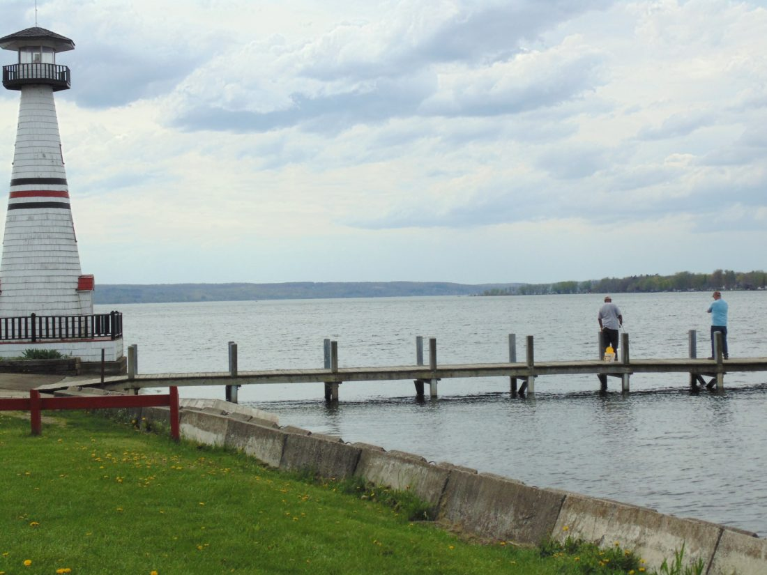 Fishermen are pictured at the dock in Celoron on Thursday afternoon. Extending the sewer around Chautauqua Lake is geared to improve water quality while reducing the amount of phosphorus entering the lake.  P-J photo by Jimmy McCarthy