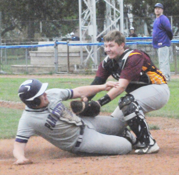 Clymer catcher Spencer TeWinkle tags out Pine Valley's Nick Gage during the seventh inning of Saturday's non-league baseball game at Diethrick Park in Jamestown. P-J photo by Matt Spielman