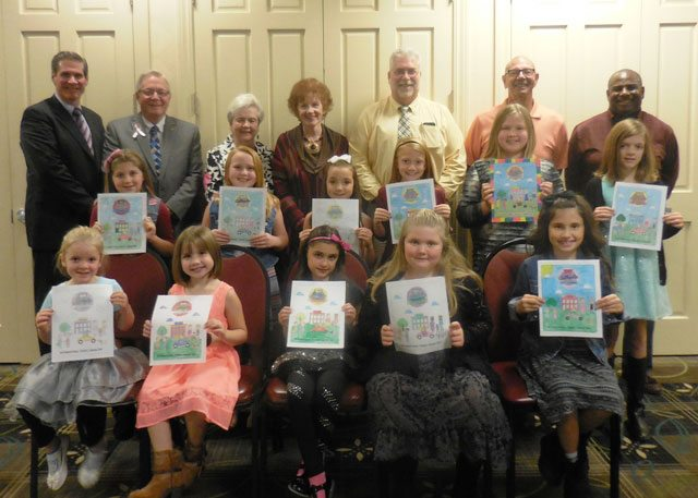 Coloring Contest winners include (front from left) McKenzie Linger, Aubreauna Wright, Alayna Bennett, Gracee Walker, and Ali Pierce; (second row) Kendra Boyd, Calee Ferrell, Ava Gatten, Alexis Cline, Kayla Mazon, and Ava Rohr; with officials (back) Scott Winwood, Weirton Mayor Harold Miller, Donna Bohach, Janet Stagani, Gordan Anderson, Bob Campana, and Dan Dudley. (Submitted photo)