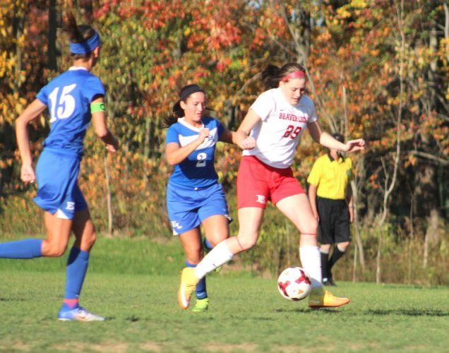 Beaver Local's Jenna Riccardo (29) tries to keep the ball away from East Liverpool's Madison Prince (2) during Wednesday's match at Beaver Local High School. Also shown is East Liverpool's Emily Brereton (15). (Photo by Joe Catullo).
