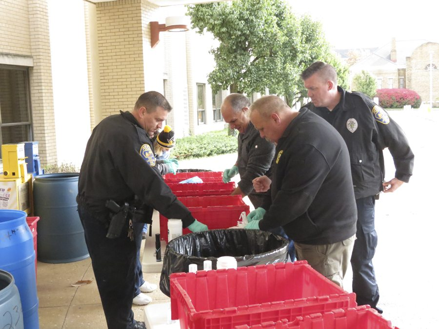 Members of the East Liverpool City Hospital, along with the East Liverpool Police Department collected unused and expired medications at the hospital's main entrance Saturday. (Photo by Steve Rappach)