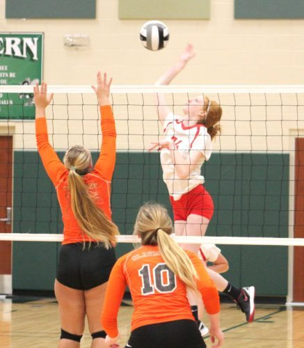 Beaver Local's Madison Smith spikes the ball at Claymont's Sadie Zurcher on Tuesday at Malvern High School. (Photo by Joe Catullo)