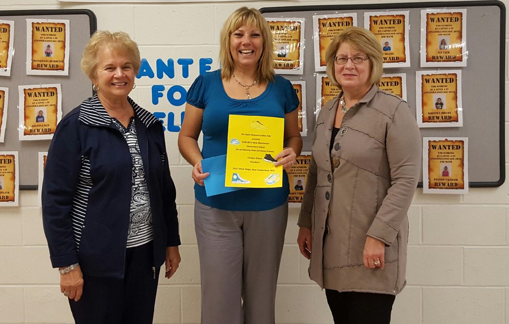The Point Pleasant Ladies Aide presented a check to New Manchester Elementary School to buy needed shoes for students. Pictured (from left): President Carolyn Allison, New Manchester Elementary School Principal Cindy Virtue and Vice-President Lisa Subrick. (Submitted photo)