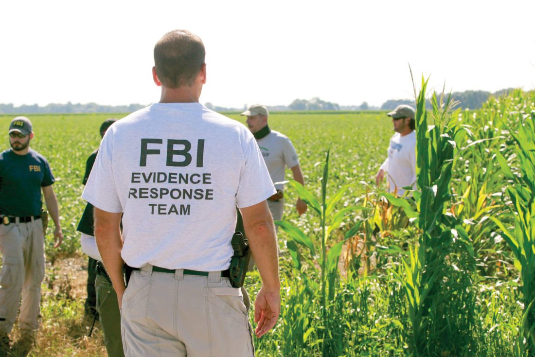 In this July 22, 2016, file photo, law enforcement officers search for missing University of Toledo student, Sierah Joughin, on James Worley's property in Delta, Ohio. The family of Joughin, who investigators say was abducted and killed by a neighbor with a hidden past, wants Ohio lawmakers to follow the lead of at least seven other states that track all sorts of violent offenders. (Cameron Hart/The Blade via AP, File)