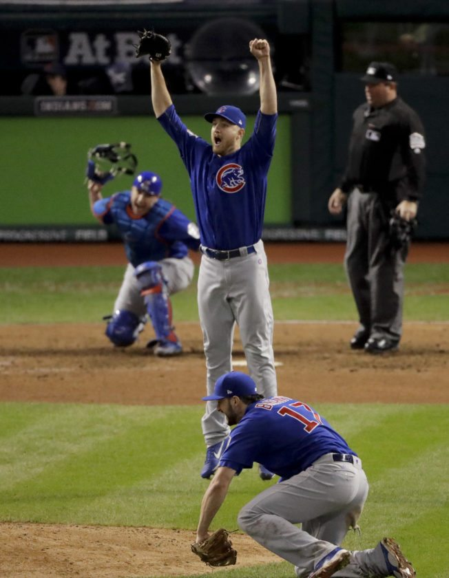 Chicago Cubs relief pitcher Mike Montgomery celebrates after after Game 7 of the Major League Baseball World Series Thursday, Nov. 3, 2016, in Cleveland. The Cubs won 8-7 in 10 innings to win the series 4-3. (AP Photo/Charlie Riedel)