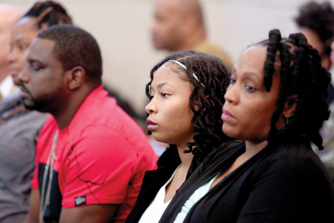 From left, Sam Dubose's, brother Aubrey DuBose, Sam's daughter Chyna-Shakura DuBose-Reid, and Sam's fiancee DaShonda Reid, listen to a Cincinnati police interview of Ray Tensing, at the Hamilton County Courthouse, Thursday, Nov. 3, 2016, in Cincinnati. (Cara Owsley/The Cincinnati Enquirer via AP, Pool)