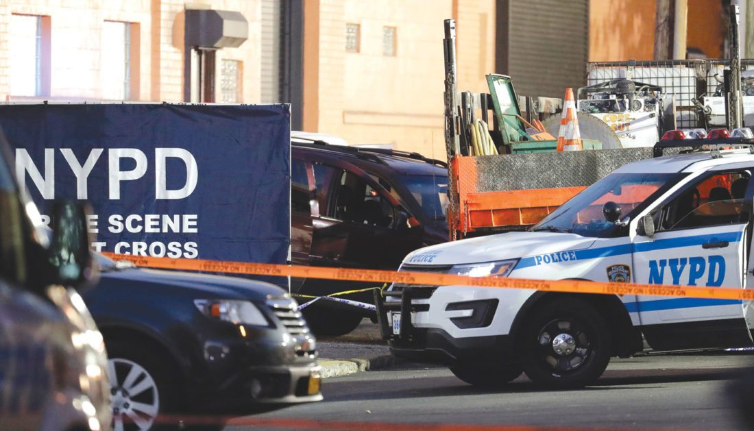 A vehicle, center, involved in a shooting with New York City Police officers is part of a crime scene in the Bronx borough of New York, Friday, Nov. 4, 2016. Officials say two New York City police sergeants were shot, one fatally, in a gun battle with a home invasion suspect. A police spokesman says the robbery suspect was killed in the gun fire exchange. (AP Photo/Julio Cortez)