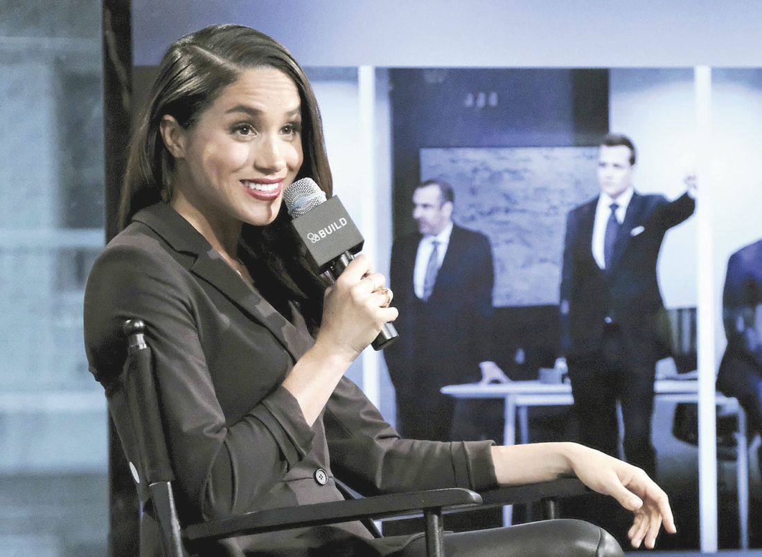 "In this Thursday, March 17, 2016 file photo, actress Meghan Markle participates in AOL's BUILD Speaker Series to discuss her role on the television show, ""Suits"", in New York. Britain's Prince Harry has condemned racist abuse and harassment of his girlfriend Meghan Markle in the media, issuing a highly unusual statement Tuesday Nov. 8, 2016, that confirmed the relationship and expressed concern for her safety. (Photo by Evan Agostini/Invision/AP, File)"