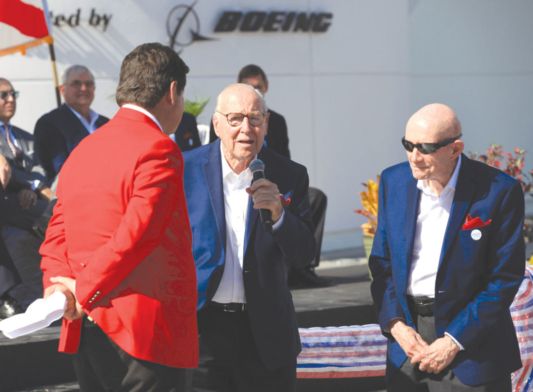 Astronaut Jim Lovell, center, speaks, accompanied by fellow astronaut Tom Stafford, right, during the ribbon cutting ceremony for the Heroes and Legends exhibit at the Kennedy Space Center Visitor Complex in Florida on Friday, Nov. 11, 2016. At left is the master of ceremonies, John Zarrella, formerly of CNN. (Kevin O'Connell/NASA via AP)