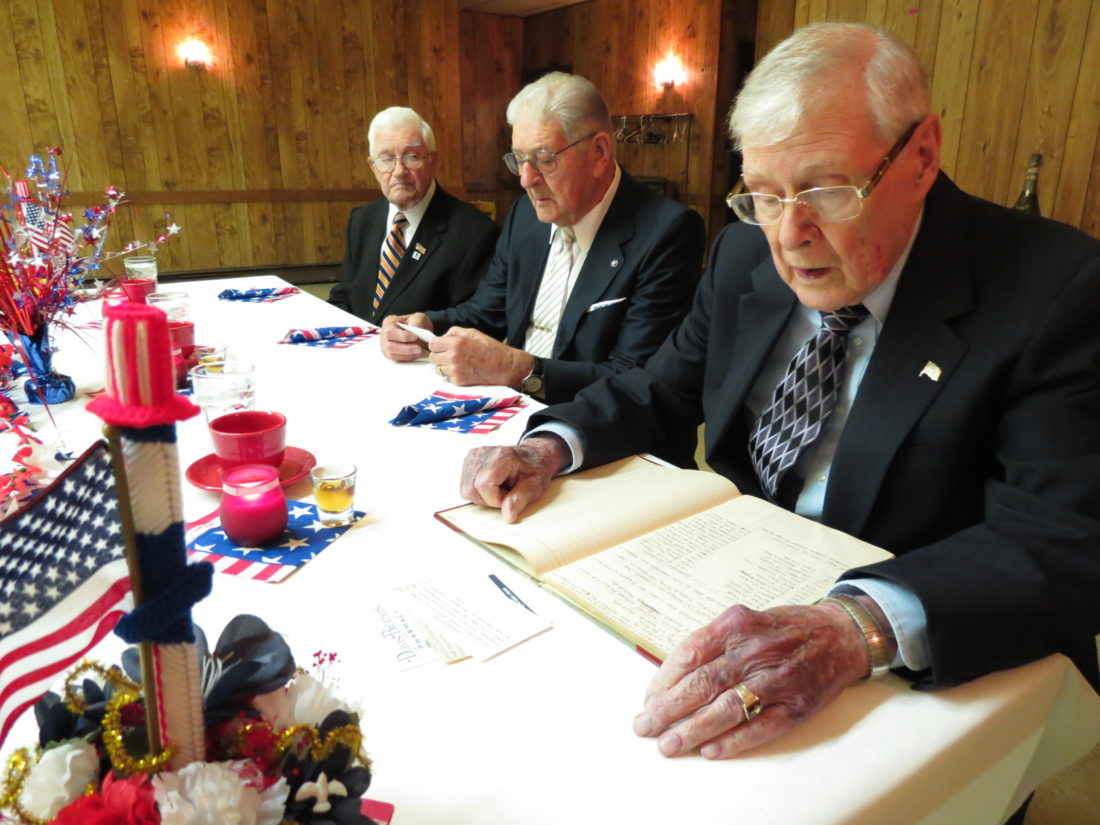 "Kenneth ""Pat"" Kessel (right), chaplain of the New Cumberland Last Man's Club, reads the minutes from the 2015 meeting on Friday. The group, which has only three members remaining, held its annual Veterans Day meeting at the Adam Poe VFW Post 3526 in New Cumberland. With Kessel are (from left) John Kuzio and Don King. (Photo by Stephen Huba)"