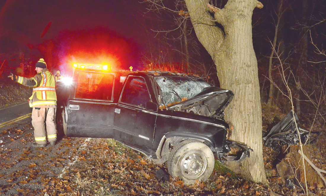 A pickup truck rests against a tree off Waterford Road in Unity Township after an accident just after midnight Saturday, killing one teen and injuring two others. (Photo by Patti Schaeffer)