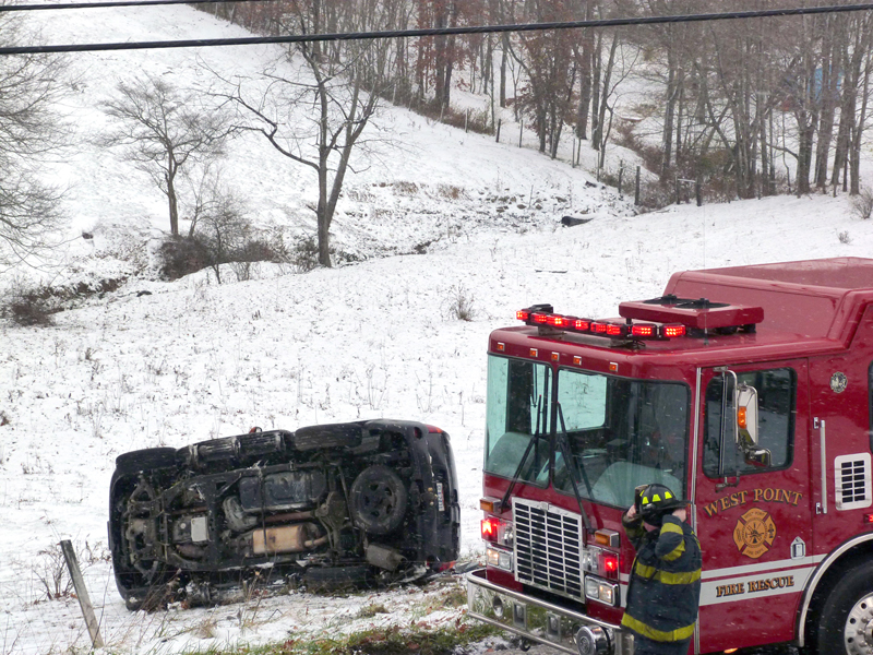 An SUV reportedly struck a patch of ice on the roadway and flipped on its side, landing in a pasture off Osbourne Road in Madison Township at about 11 a.m. Sunday. No one was hurt. The vehicle was occupied by Rose and Jessica Bentley, both of Salineville, although it is not known who was driving. The Lisbon Post of the Ohio Highway Patrol and West Point firefighters responded to the scene. (Review photo)