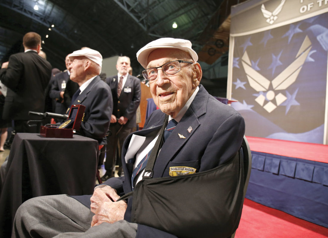 "In this April 18, 2015, file photo, two members of the Doolittle Tokyo Raiders, retired Lt. Col. Richard ""Dick"" Cole, seated foreground, and retired Staff Sgt. David Thatcher, seated background left, pose for photos after the presentation of a Congressional Gold Medal honoring the Doolittle Tokyo Raiders at the National Museum of the U.S. Air Force at Wright-Patterson Air Force Base in Dayton, Ohio. (AP Photo/Gary Landers, File)"