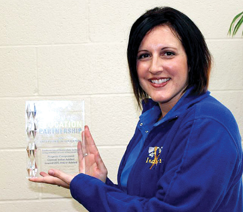 Southern Local Elementary Principal Kristy Sampson poses with an award the school received from the Eastern Ohio Education Partnership, given to schools that received high marks on its value added components through the Ohio Department of Education on state report cards. (Submitted photo)